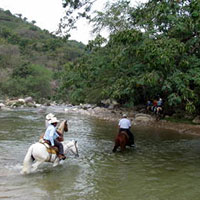 horseriding-over-river